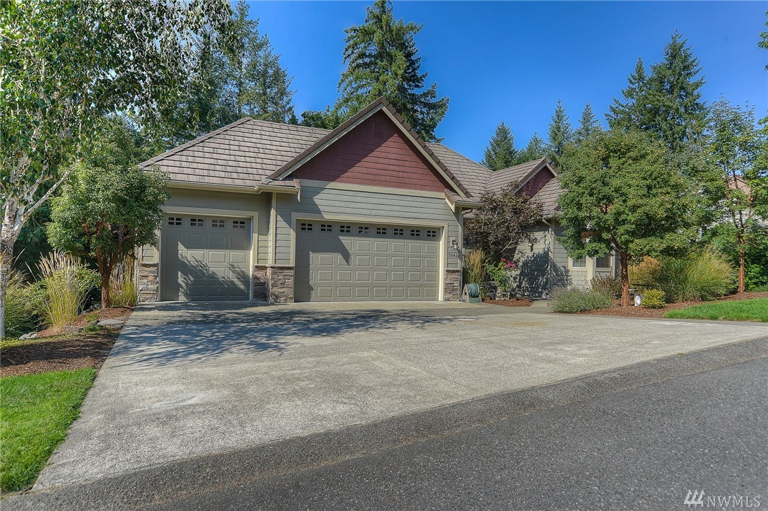 Gorgeous Cougar Ridge home w/ newly updated kitchen on lrg half acre lot. 3,518± SF 4 BD , 3 BA, w/deck overlooking woodland forest. Main flr master suite w/walk-in shower & door leading to back deck. Tile roof w/copper accents, wainscoting, crown molding, hrdwds quartz & tile throughout, filled w/natural light. Lower level boasts huge open bonus rm w/stunning flr to ceiling tile frplc, wet bar, theater rm & french doors open to outside covered patio & expansive yrd backs up to McLane Creek