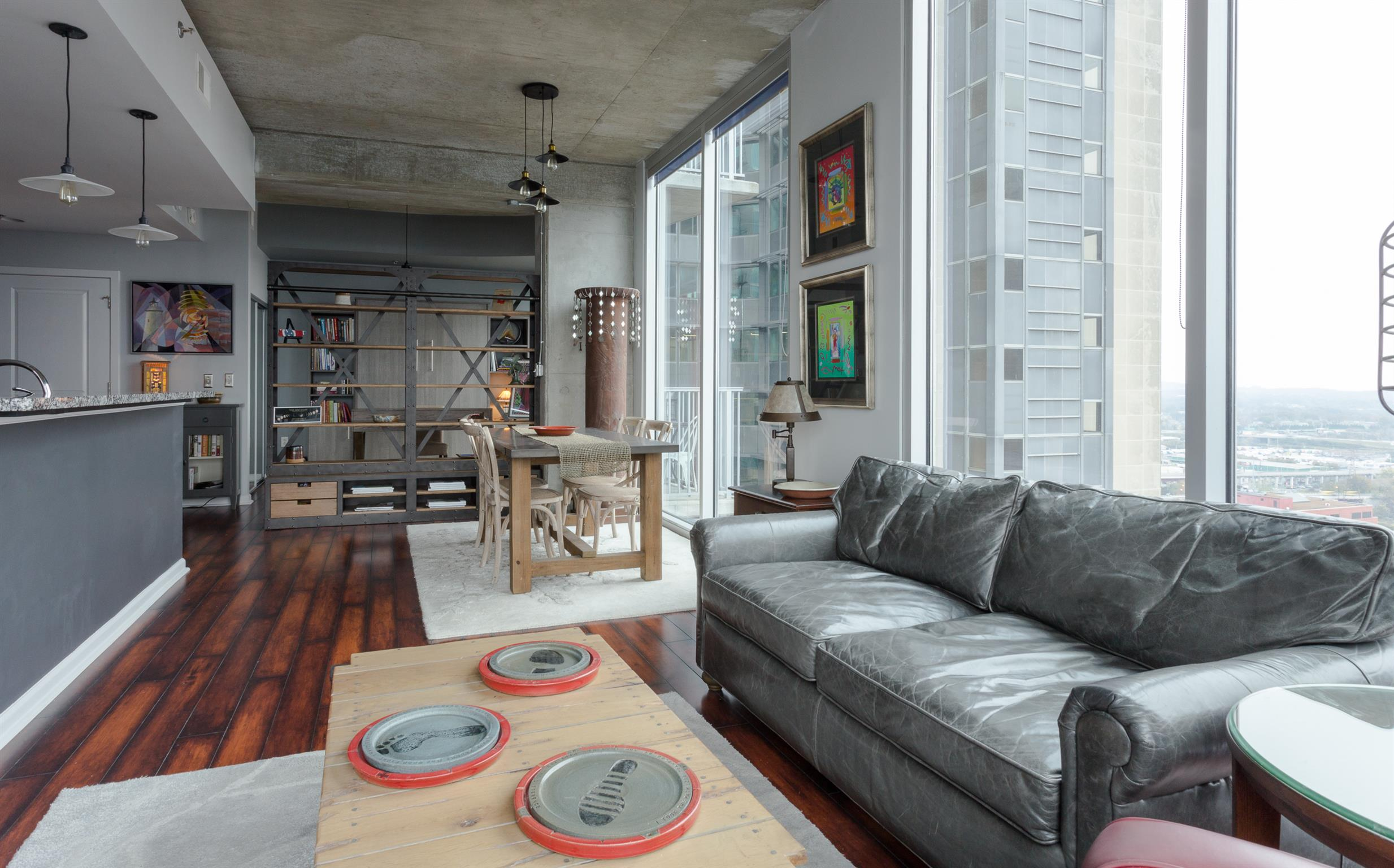 """SPECTACULAR RENOVATION WITH UNOBSTRUCTED CORNER VIEWS! See the crowds at Titans stadium and walk on over. Custom tile. 5"""" plank hardwoods. Custom Murphy bed. 2 parking spaces. The best of city living."""
