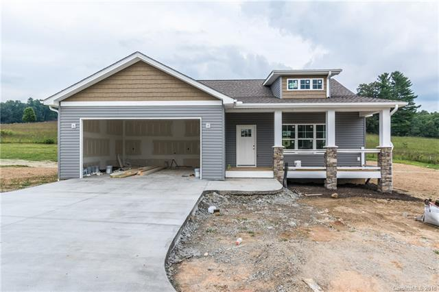 New Construction in Waters Edge subdivision located in the Etowah Community.  This location is conveniently located only minutes to Historic Downtown Hendersonville and Historic Downtown Bervard.  Seated on generous half acre +/- lots, city water, septic, natural gas, this home boast hardwood, tile, elegant cabinetry, granite, and many other top notch finishes.  Dining and entertainment are close by as well as Etowah Valley Golf Course.  Schedule your viewing today! Taxes to be calculated upon completion.