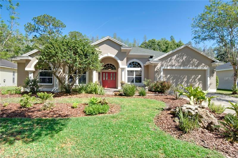 """Hannah-Bartoletta at it's best! This pristine new listing is located on a breathtaking conservation home site in the beautiful village of Tremont in Tampa Palms. It has great curb appeal with lush mature landscaping and an elegant column entry. This popular floor plan offers 3 bedrooms+den, den may be used as 4th bedroom. The home has been remodeled over the years including a new roof in 2008! The formal area is stunning with 18x18 tile floors laid on diagonal, elegant plantation shutters, designer perfect paint, soaring 12 ft. ceilings and 8 ft. doors. The kitchen is a cook's delight with rich granite counter tops, 42"""" raised panel maple cabinetry, custom lighting package, glass front upper cabinetry, stainless steel appliance package and designer tilebacksplash. The family room boasts a built-in entertainment center, surround sound, a cozy fireplace complimented by a slate trim, laminate wood floors and soaring 8 ft. sliding glass doors. The master retreat offers great conservation views and a remodeled master bath. It features beautiful ceramic tile, granite counters, custom cabinetry, glass block shower and plantation shutters. Enjoy the Florida lifestyle while lounging on your private lanai over looking a soothing pool/spa package. This home is conveniently located near top rated schools, scenic parks and playgrounds. Tampa Palms is an award winning community which is just minutes to USF, Moffitt Cancer Center, Florida Hospital, I-75 and Wiregrass Regional Mall.Welcome Home!"""
