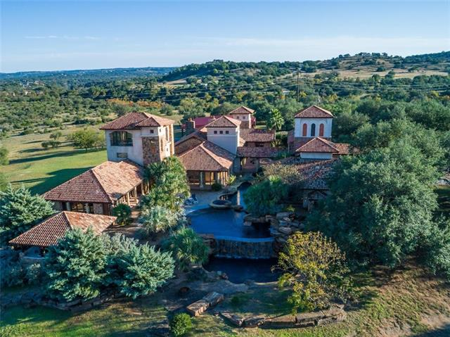 68+ ACRE Estate w/ Expansive Hill Country Views! UNZONED Bordered on 2 sides by Fall Creek  This Custom Built Home includes a Hacienda w/ 2 Guest Casitas- 13,527 sf, Guest House/Barn- 4,428 sf & Foreman's House- 1,430 sf. Lighted Riding Arena, 4 Stables, 75x75 Covered Pavilion, 2 Rain Collection systems, 6 Car Attached Garage & Equipment Barn. Wildlife Exempt Mgt Plan for LOW taxes. Massive Oak trees, 3 level Pool & Koi Pond. Original Owner. Within 30 min to Hill Country Galleria Shopping & Restaurants.