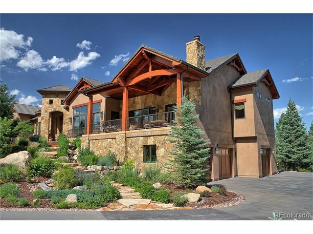 Impressive in scale and design! This custom home has a flat 1.77-acre lot, offering an impressive resort-like setting, w/ natural stone exterior & beautiful water features ideal for living the Colorado lifestyle. The luxury ranch-style home has an open floor plan w/ custom refined and elegant finishes throughout; hickory wood floors, wood beamed cathedral ceiling, granite counter tops, Subzero & Wolf appliances.  Walk-out from the great room onto a covered stone terrace w/ an exceptional outdoor fireplace. Master suite, with its large walk-in closet, washer & dryer, also has a private balcony with stunning mountain views. The main level includes guest suite, Gourmet kitchen, & the library/office, w/ built-in shelving. The LL is where you will find the family & game room. Multiple private terraces to enjoy the awe-inspiring views of the mountains.  The 4-car garage includes an elevator to the main level. Ownership in the Resort allows you to purchase a Broadmoor Membership.