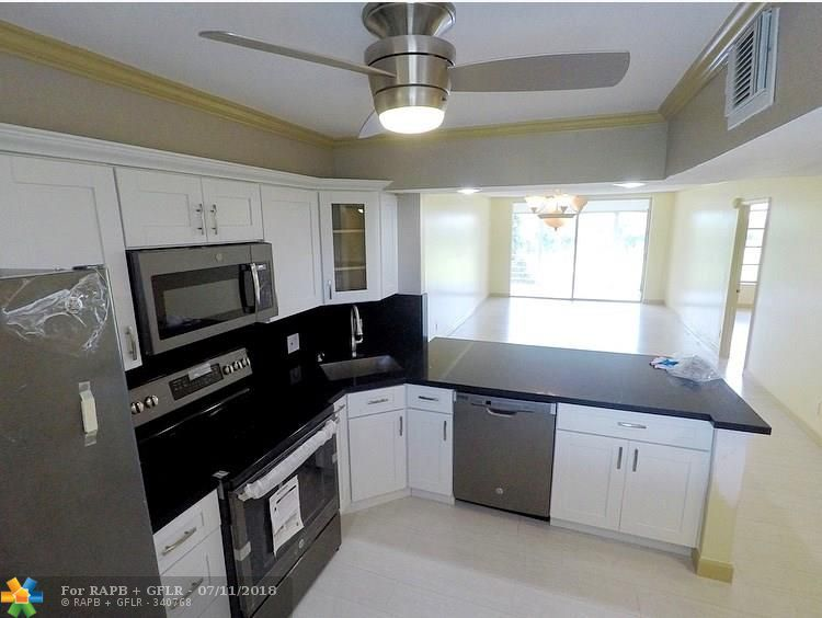 Remarkable updated Condo in beautiful Palm Aire Country Club. Wake up to gorgeous golf course view and serenity. Flooring has been updated to a wood based laminate, porcelain tile floors in both bathrooms, new toilets, new sinks, 3 big closets in master for plenty of storage, new kitchen with GE appliances, Quarts in kitchen and bathrooms and new water heater.  *BONUS* 5 MILES FROM POMPANO BEACH  (15MIN) Isle Casino Racing Pompano Park (ACROSS THE STREET) PALM AIRE PUBLIX  TURNPIKE & I95 (5MIN)