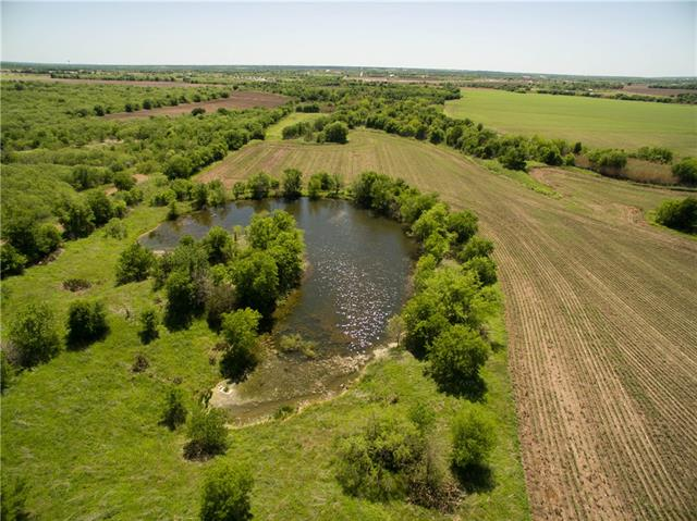 Beautiful country acreage in Manor & just next to Elgin, Within minutes of downtown Austin & airports, minutes to Elgin ACC campus. This unrestricted land has easy access to Hwy 290 available for commercial, residential or farm. 9 Aqua Water meters along Giese Lane. Trees, open fields, a creek and 2 ponds. Farmer lease through October 2017 that can be renewed for continued Ag exemption. Great location for developers & investors.