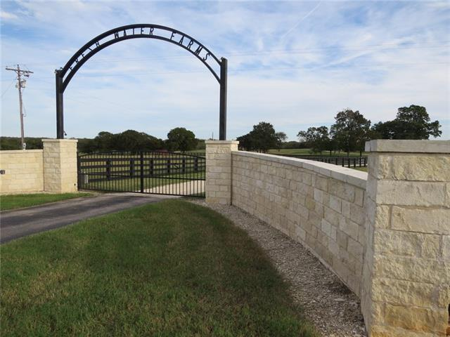 Horse Lover's Dream Property! Spacious, Custom Home with Awesome Porches and Views. There are multiple Equipment Buildings, Covered 70' Round Pen, 2 barns (multiple stalls, clean & well maintained, single bedroom bunkhouse, breeding facilities, room for hay storage), beautiful property layout, Healthy Oaks, Pecans & Persimmon Trees, Stock Tank, Highend Fencing & Cross-Fencing w/Solid Wood Equestrian Fencing. Scenic Property. 100% of Water & Mineral Rights to convey. Immaculately Groomed and Managed.