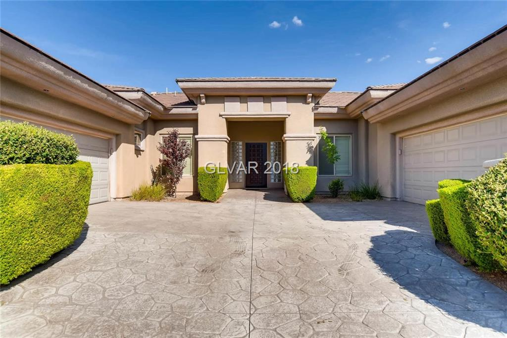 MUST SEE! Amazing Single-story in Anthem Community, rarely-used vacation home on a 0.7 acre lot, on a cul de sac. Backyard landscaped w/ elevated spa, waterfall, BBQ, fire pit, & 2 patios. Kitchen w/ maple cabinets, granite counters & SS appliances. Limestone flooring, high ceilings, wet bar, custom stone wall, fireplace etc! Experience the wonders of nature. soaking in the SPA, listen to the sound of water fall, gazing the stars at night, etc