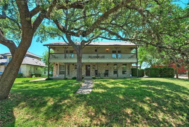 This lovely home is situated on a large lot (over 1/3 acre) backing to the Live Oak golf course. 2312 square feet, 3 large bedrooms, 2.5 baths, updated, lots of natural light. Awesome curb appeal, gorgeous oak trees. 2 car carport. Workshop off of carport. Covered outdoor living area. All tile and hardwood floors. No carpet. Upstairs balcony across the entire front of the home. Lake Travis Schools and active Lakeway Communuty!