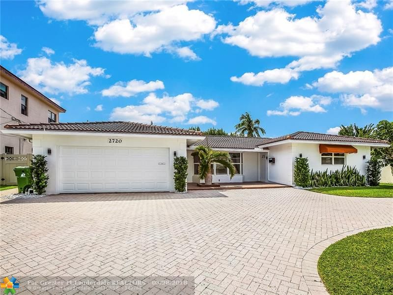 This beautiful fully furnished 3 bedroom 2 bath home offers the perfect setting for boaters and entertainers. The spacious pool area has 75ft of waterfront and includes a newer dock. The interior open floor plan provides for another great entertainment area. The bright open kitchen has granite, stainless steel appliances and marble.  Tastefully furnished by Miami designer Jeanine Johnsen. Just bring your boat your toothbrush and move right in! Ocean access, one fixed bridge 13.5 ft.