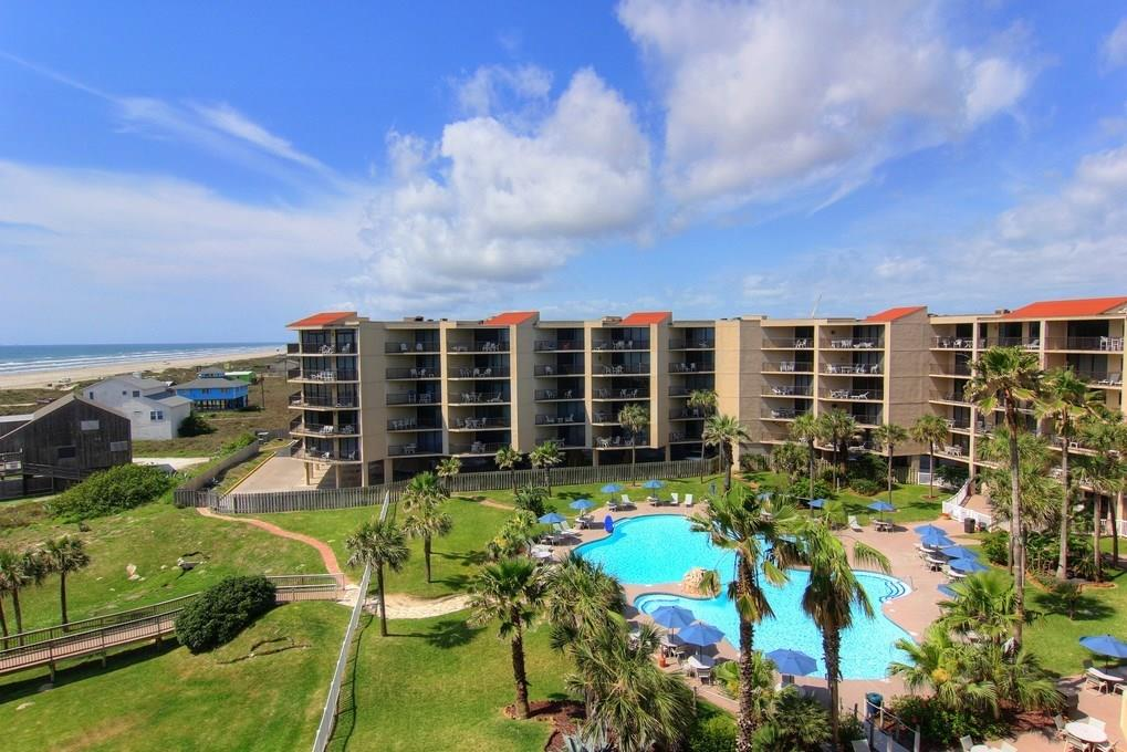 Rarely available, top floor condo with fabulous views of the Gulf, Beach and Pool. This one bedroom unit has an open kitchen, dining and living area, a full bath, one bedroom and a large covered balcony overlooking the complex's lush grounds out to the Gulf. The Sandcastle has a beautiful pool, hot tubs, a boardwalk to the beach, a conference center, fish cleaning facility, tennis courts and a work out room. This beautiful in town location has easy access to shopping, dining, marinas and airport. The complex is being completely renovated in the wake of Hurricane Harvey. Here is an opportunity to choose the interior finish out and appliances you prefer. Existing appliances and furnishings are in climate controlled storage. All units will have impact glass window walls on decks and be rebuilt with owner options to upgrade beyond builder grade. Building insurance is $1,667 per year and 2017 taxes were $4,478. Potential for excellent rental income when repairs are complete.