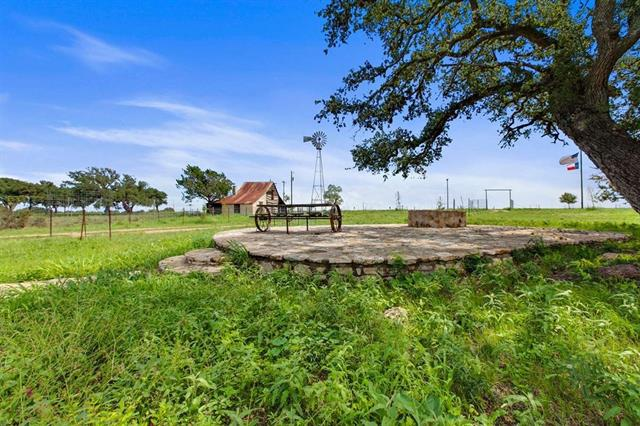 226.19 High Fenced acres located in the heart of the Hill Country wine trail!  Amazing property approx. 1/4 mile off of HWY 290, minutes from downtown Stonewall & Fredericksburg. Approx 2900 ft of frontage on Lower Albert Rd, the access is awesome. Approx 95 acres of fields and the rest is full of large mature Oaks. Cedar has been removed, newly high fenced & cross fenced. Stocked with several nice white tail deer. Improvements include a nice little German style cabin & barn for storage. 1 water well