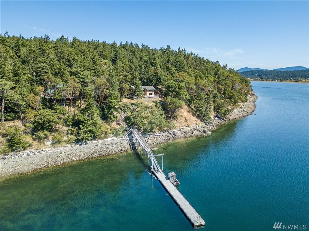 Gorgeous, Tranquil Center Island Home with 60' Deep Water Dock South facing w Sweeping dramatic views through Lopez Pass. Creative contemporary 1960 +/- sqft. 2 BD, 2 Bth home w rooms for guests. Spacious Great Room design w light filled gourmet kitchen. 1100 of sunny deck, garden space & outbuilding. Center Island Amenities including community waterfront, boat launch, airstrip, dock and community water system. The perfect San Juan Islands Getaway