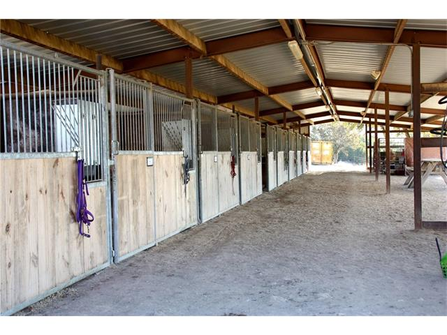 Deer Canyon Stables is a unique 16.46 acre horse property that boasts panoramic views of the hill country and lake travis. Close to amenities in Cedar park and just minutes from Jonestown w public lake access close by. Keep the property as a boarding/lesson facility or use it for personal use and build your dream home! Surrounded by acreage tracks, very private. 