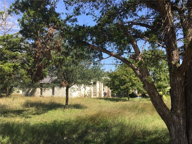 Very unique property with an unlimited potential for commercial, residential and/or farming (think: landscaping service, manufacturing, industrial, shipping). This approx. 21.7 acre tract laid out in a 2-acre wide rectangle w/ caliche road down the middle. Structures include a 3,000 sf white stone house custom built in '94 + outbuildings (guest house, warehouse, office). Original use was family estate & trucking business. Close to Circuit of Americas, Hwys 45 & 30. Fast route to airport. Gated. Surveyed.