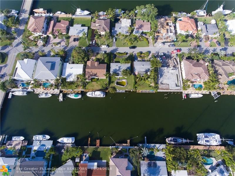 70' waterfront home in Lauderdale Harbors with no fixed bridges. Approximately 15 minutes from the dock to the open ocean. Private yard with south facing views. Easy to show!
