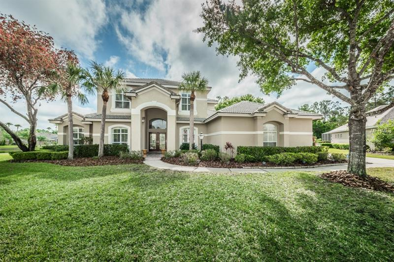 """CUL-DE-SAC executive home, in gated GOLF community. One of the most magnificent """"one of a kind"""" lots in the highly regarded area of Westchase in Tampa, FL!  Gorgeous EXECUTIVE home on .38 acre lot (100x165!) on CUL-DE-SAC in GATED Harbor Links…this very special 4 bed, 3 full bath/1/2 bath, 3 car side-load garage home is the kind of home that creates memories for a lifetime.  From football games and tag on the front lawn to cozy Holidays in the family room by the FIREPLACE…well-suited for so many lifestyles - whether the entertainers hosting the Holiday cocktail party, slumber parties for the little ones or those seeking privacy, space, and serenity…without compromising on supreme location and beautiful planned development.  Offering very generous living space both indoors and out…this home offers a separate OFFICE, formal living room and dining room spaces, a great LOFT space with awesome built in wall unit, complete with workstation. Very comfortable floor plan with elegant DOWNSTAIRS MASTER SUITE (with BRAND NEW """"DREAM"""" Master Bath!!). Secondary 4 bedrooms upstairs include a full separate bath AND a JACK & JILL full bath (NEW SHOWER). The swimming POOL is one of the LARGEST in all of Westchase!  Amazing outdoor living with plenty of covered lanai space AND outside deck, very generous back FENCED YARD - ALL with lovely shimmering WATER views of pond!! Perfectly located for those needing quick airport access, reasonable commutes to Downtown Tampa or St. Pete or the Beaches!"""