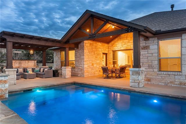 This is a gorgeous one story luxury home located in Rough Hollow of Lakeway.  The backyard Oasis includes a KB custom pool with Eco-Smart series of Green Pool Equipment. This equipment offers maximum efficiency for your swimming pool and spa. The pool and hot tub are heated so you can enjoy the pool all year!! There is also a nice plexiglass covered Pergola so you can enjoy your outdoor living space no matter what the weather. Other features include; Double oven, central vac, two water heaters, security.