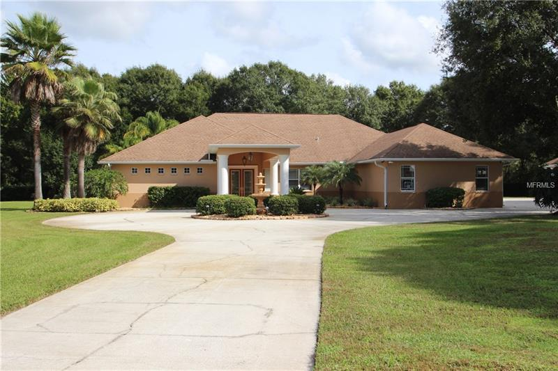 """This beautiful custom home is located on a gated 4.55 acre home site with stately oaks, manicured lawn & gardens. The main house has 3845 sq ft, 4 bedrms, office, 3.1 baths, screened in lanai w/brick pavers, pool & spa (pool refinished,screen & cage refurbished), 8 ft doors, porcelain tile, 7"""" baseboards, crown molding, flush mounted ceiling speakers throughout, art lighting in formal rooms, large kitchen with all new S.S. appliances, custom cabinets, granite counters, marble backsplash. Large master suite with over sized mstr bath 6' soaking tub, large shower w/double heads, his & her walk-in closet. Large bedrooms, 960 sq ft garage. Secondary building (in-law suite or office) is 1000 sq ft, full bath, partial kitchen w/sink & washer/dryer hookup, a 170 sq ft storage room, 413 sq ft carport. Exterior has a circular driveway with a fountain feature and portico, pump house, 1250 linear ft of 4 rail-5 ft horse fencing. Horses are allowed. This home has so many upgrades you need to see to appreciate."""