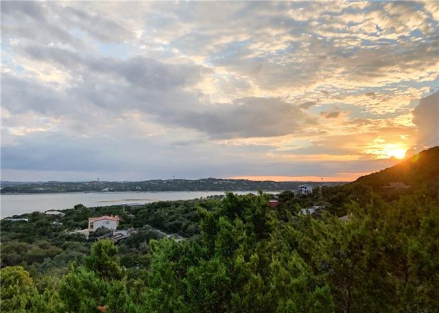 """Skyline views of Lake Travis main basin from this soft contemporary w/4 decks, 3 balconies & a covered patio. Deeded access to Comanche cove. """"Wall"""" of windows in open, flex dining & Great Rm w/wet bar. Kitchen boasts 42"""" cabinetry, breakfast/serving bar & breakfast area w/access to balcony for grilling. Owner's suite reveals gas log fireplace, His/Her vanities & balcony w/bird's eye view of the lake. Lower level features secondary bedrooms, utility room w/sink & flex 4th BR/study. Oversized garage!"""