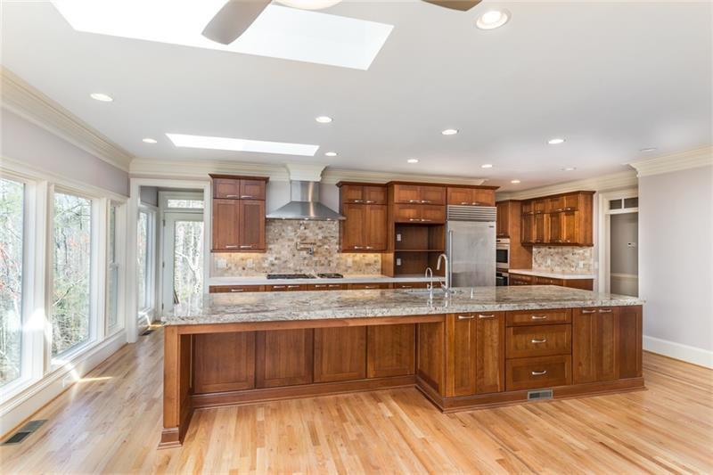 Natural light abounds in the totally remodeled kitchen! Stunning granite, custom vent hood, commercial grade fridge, oversized chef's cooktop, double ovens, microwave AND wine cooler!!!