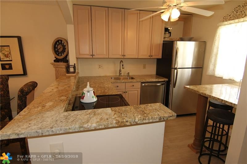BEAUTIFUL REMODELED UNIT, OPEN KITCHEN WITH GRANITE COUNTER TOPS, NEW STAINLESS APPLIANCES,LUXURY WATERPROOF LIGHT OAK FINISH LAMINATE PLANK FLOORING. NEW AC .TURN KEY,COMES TOTALLY FURNISHED. ENCLOSE PATIO WITH A NICE VIEW. LOW MAINTENANCE ONLY $233 MONTHLY. VERY ACTIVE COMMUNITY: PETANQUE,SHUFFLEBOARD,BINGO,EXERCISE ROOM,SAUNA,HEATED POOL AND MUCH MORE. 55+
