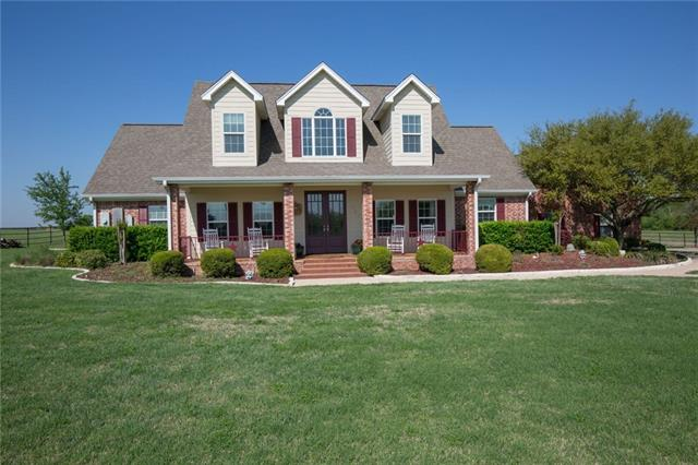 Outstanding Holland TX Ranch. Beautiful home on 31.5 acres of pastures with creek. Custom home w/open floor plan. Spacious family room w/wood floors, stone fp. Formal dining. Gourmet kitchen, ctr island, granite ctrs. 1st floor master, office/bdrm each w/baths. Two 2nd floor bdrms. Custom patio w/stained concrete, brick fire pit, peaceful pasture views, tree-lined creek. 100% fenced, Bermuda grass. Livestock barn/shop. Elec gate, pipe-fenced yard. Great Central Texas location near all conveniences.