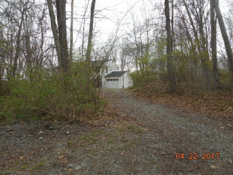 Beautiful wooded lot with a 4 bedroom and 2.5 bath Colonial in need to total renovation. Large Living room and Country Kitchen, level rear wooded lot. Sold AS IS ...