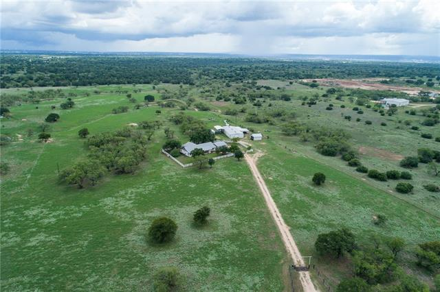 This is a must see - 22 acres of beautiful Texas hill country! Outbuildings, stables, ponds to name a few amazing features of this property. This is a great opportunity for horses, and country living on this sprawling land with a lovely ranch style home! Just 10 minutes from Marble Falls amenities, restaurants, and more! This is a great family compound for primary home or weekend getaway! The property is on 36+/- acres. The possibility of the house for sale with 22 acres. See Agent. AG exemption.