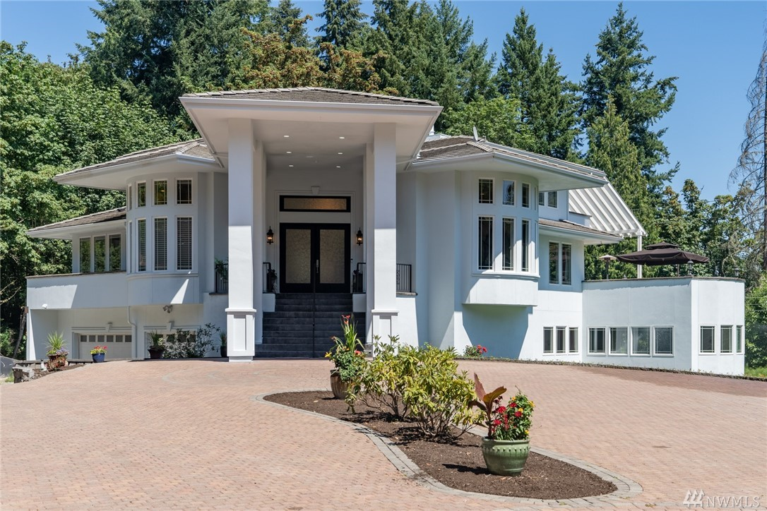 """Sited on 2+ private acres, this """"HGTV Design Challenge"""" winning estate home is the crown jewel of the desirable Cascade Park subdivision. Minutes to Microsoft, easy commute to Bellevue/Seattle. Enjoy the custom stone Summer kitchen (w/2 gas grills, wine fridge and sink), relax by the gas fire pit and entertain on the almost 2,000 sqft deck, swim laps in the heated indoor pool (w/ stunning waterfall), watching the newest release in the theatre, or playing a round of billiards. The ideal RETREAT!"""