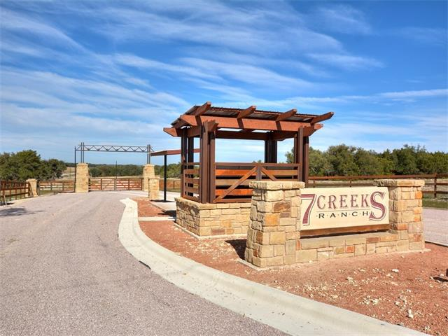Ag exempt 12.25 acre home site in all new gated 7 Creeks Ranch subdivision. Perfect balance between open pasture and wooded areas. Build the home of your dreams here and enjoy the gorgeous hill country views and the privacy that comes with having your own acreage. Community has paved roads and minimal restrictions. Owner is Texas Licensed Real Estate Agent.