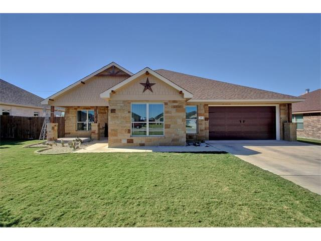 MOTIVATED SELLER! MUST SEE this immaculate barely lived in single story.  Conveniently located near IH-35, new grocery shopping plaza, and SH 130 toll rd. Featuring an executive office, beautiful hardwood floors, gourmet kitchen with all stainless steel appliances with country brick backsplash that includes a built in desk, and a backyard that boasts beautiful views. Brand new insulated garage door and 3 car tandem garage perfect for storage.