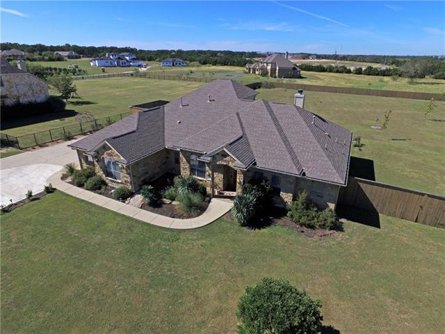 $50,000+ in Upgrades & Improvements! 2 acre lot home w/open floorplan~natural light~hardwoods & tile. Gourmet kitchen w/granite~island~gas cooktop~built-in-microwave~double oven. Master suite bath w/natural light~double vanity~oversized shower~garden tub~walk-in closet. Spare beds share Jack & Jill bath. Office/4th bed. Bonus room upstairs.  Private backyard w/great entertaining area to enjoy cascading Texas sky. RV/Boat Parking. Many planted trees. HOA park has picnic area w/access to San Gabriel River.
