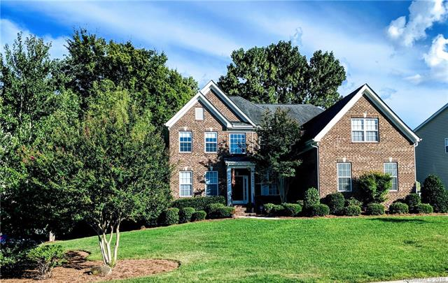 """NEW LOWER PRICE!  Impressive custom-built home on large wooded private backyard with mature landscaping and expanded deck. Located in the golf course community of Olde Sycamore, & fantastic Union County Schools. The open concept first floor unites the living, dining and kitchen spaces and includes in-ceiling speakers. The chef's kitchen, upgraded in 2017, features new quartz counter tops, huge waterfall island, marble backsplash & custom hardware. Professional grade Monogram appliances include a 36"""" gas range with stainless griddle, 48"""" built-in refrigerator & wine chiller. The stunning upstairs Master Suite has extensive closets.  Also upstairs are 3 other bedrooms, one of which has a private bath. The rec room has large windows overlooking the backyard. This house is in move-in ready with custom plumbing and lighting fixtures, fresh paint throughout and newer AC units! The auto-enthusiast 3-bay garage, high-lift doors and custom flooring. The community features a pool and clubhouse."""