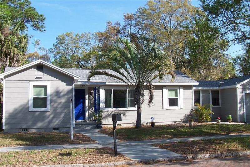 Charming corner lot, 2 BR/1BA, minutes from Boca Ciega Bay and Downtown Gulfport, with shops, restaurants, and the city of Gulfport Casino Ballroom. Sliding doors lead to covered patio. Attached 1 car garage with washer/dryer