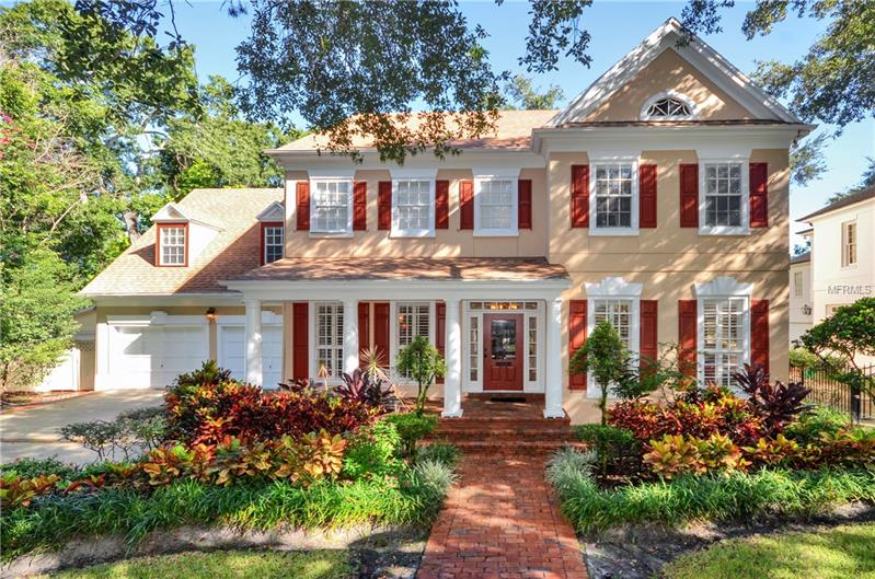 THIS GORGEOUS TRADITIONAL home sits just 3 homes from Bayshore! Custom-built by Bayfair, it offers exquisite architectural detail, inside & out on one of South Tampa's prettiest tree-lined streets.  Wood floors sweep through generous rooms surrounded by tall windows, complex crown mouldings, columns, tall baseboards, coffered ceilings, tray ceilings, built-in cabinetry and other features expected in fine South Tampa homes.  Kitchen opens to family room and has both a breakfast bar with blown glass pendant lights and a window area that accommodates a large table.  The kitchen itself is a chef's delight with a Thermador gas cooktop, new Samsung SBS refrigerator, Bosch diswhasher, and a wall oven and microwave.  Bright kitchen cabinets topped with beautiful granite countertops, together with an island offer ample work surface.  Butler's pantry offers extra staging area for large gatherings in the formal dining room.  French doors lead from spacious downstairs office with built-in shelving and its own half bath out to custom-framed screened porch with brick floors that match the brick patio in the back yard.  Two stairwells access upstairs, one giving special privacy to guest suite over garage. Double doors open to master suite with 12' tray ceiling in the bedroom, a dressing suite with his & hers closet areas and a bright, spacious master bathroom with all expected features.  Truly a special place by the bay! Sold as-is.