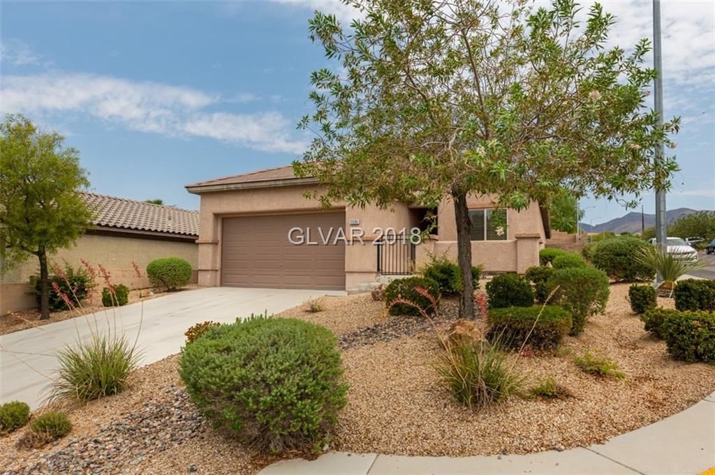 Very popular Pulte single story floor plan! Corner lot across from small park and walking distance to splash pad. This immaculate home features new porcelain plank flooring, stainless appliances, wood shutters, breakfast bar and more! Front porch, covered rear patio and private low maintenance professionally landscaped yard! Home is zoned for some the top rated schools in the Vegas Valley!