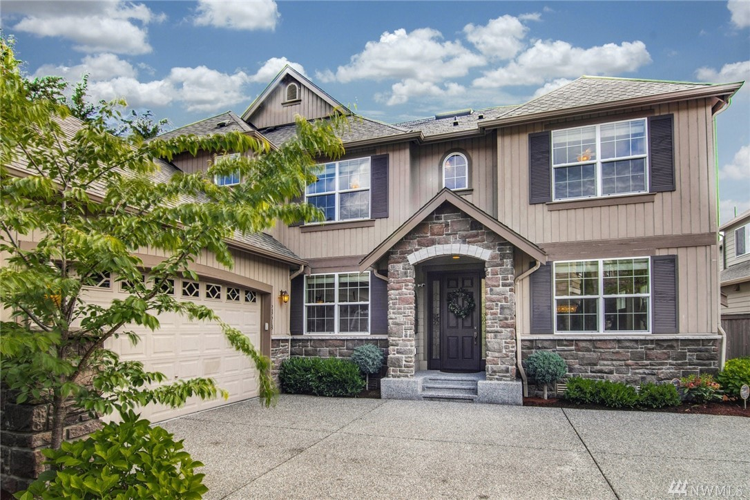 This Redmond Ridge home has great natural light, huge rooms, and a park-like, fenced backyard w/ a $30K outdoor living upgrade. The grand staircase w/ a skylight & tall ceilings allow light to fill the home. On the main floor you'll find multiple living spaces, an office, a bedroom w/ a private patio and 3/4 bath, + an open kitchen w/ a large island, granite slab, and gas stove. 2nd floor has 4BRs, bonus room, & loft. The master suite features a sitting area, soaking tub, and a dream-like closet