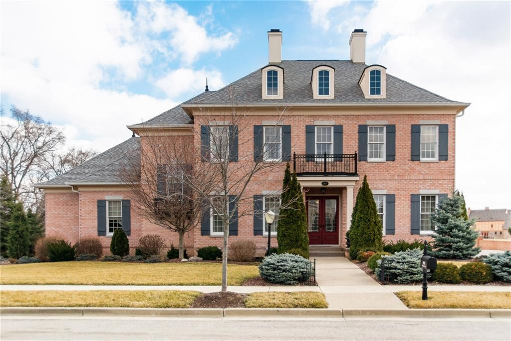 STATELY, TRADITIONAL, LUXURIOUS ESTATE! Gorgeos All brick 6 bed, 5.5 bath home recently updated w/ beautiful refinished whitewashed hardwood flrs, custom luxury light fixtures, newly refreshed/painted walls & Spectacular high end finishes throughout. Tray ceilings, office w/ coffered ceiling, built-ins, distributed sound system & radiant heated floors in master & LL bathrooms. Master Suite w/ sitting area & grand Bathrm on Main. Newly updated Gourmet kitchen w/ stunning cabinetries & high end appliances. Serene, private courtyard w/outdoor kitchen & fireplace. 4 car garage, Views of breathtaking expansive common area w/ park like setting & beautiful outdoor space.
