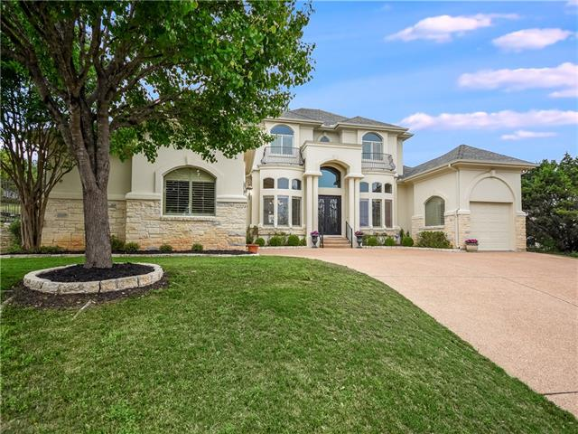 Custom home on corner/cul de sac lot with views of hill country & lake from front. Mster & 2nd bedroom on main level. Hardwood & travertine flooring. Plantation shutters. Large living areas & bedrooms. Lots of storage. Chefs kitchen w/stainless & granite. Custom saltwater pool & spa w/waterfall.