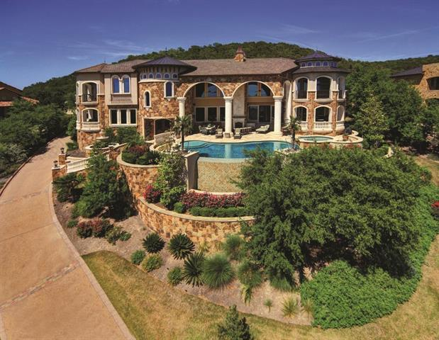 MOTIVATED!!!!Amazing estate home with UNPARALLED VIEWS OF THE LAKE AND THE HILL COUNTRY. From the moment you enter the gate up the long driveway, you realize you are on top of the world with a view to paradise!  This home has everything you could want and more ~ numerous outside areas, pool, outdoor kitchen/bathroom, sport court, huge gentleman's game room, full media room, gorgeous updated kitchen just to name a few highlights! The quality is exceptional! Truly a private estate but still close