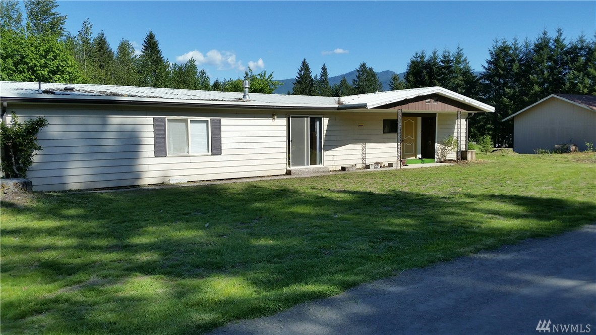 Large 1848 sq ft manufactured home built in 1974 with 24 x 50 garage and storage room. Located on 2.85 acres which includes 3 rental spaces for manufactured homes. 2 spaces are rented and the other space includes a 24 x 32 garage, rent space or build a new home.  Property has a water system that serves all the lots.  3 septic tanks currently on property.  Property is being sold AS-IS.  Steady income producing property.