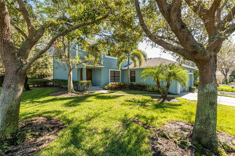 Located in highly sought after gated Caya Costa in Northeast St. Petersburg, this COMPLETELY UPDATED townhome is an end unit with three bedrooms, three full bathrooms, screened patio, fenced backyard, and an attached garage. The Chefs kitchen has granite countertops, stainless appliances, solid wood cabinetry, and a built-in butler's pantry. The spacious Living Room has volume ceilings, large windows, and a decorative fireplace. The home features maple hardwood floors, and multiple sliding glass doors, which lead to the screened lanai and well-manicured lawn. There is a bedroom located on the ground floor with close access to a full bathroom, and can be used as an office, or guest suite. Upstairs you will find the Master Suite with a large walk-in closet and dressing area with more custom cabinetry, an en-suite bath, and a screened balcony. A second bedroom and full bath complete the second floor. HOA fee $429.64 covers - Roof Replacements every 20 yrs., Exterior Painting every 7 yrs., Exterior Maintenance, Building Insurance, Community Pool, Hot Tub/Spa, Grilling Area, Pavilion, Tennis Courts, Fishing Pier, Secure Boat Storage and Boat Ramp, All Lawn Maintenance Included except bushes in Backyard, All Irrigation Water Included. Caya Costa is a Secure, Gated Community with a 24-hr Guard Gate. It's like owning a condominium, very care free! Caya Costa is ideally located within 15 minutes of both Tampa and downtown St. Pete, and just 20 minutes from the Gulf beaches. See this one today!
