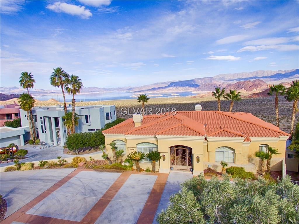 Custom dream home with fabulous views. Back of house abuts National Park with unobstructed views of Lake Mead and Mountains overlooking River Mountain Trail. Large living area on walk in upstairs level including Kitchen, Living Room, Family Room, Master and 2nd Bedroom. Downstairs with additional central Family Room and 2 bedrooms. Backyard with pool, spa, covered patio and balcony. LARGE 3 car garage and front parking. This is a true 'WOW' home!
