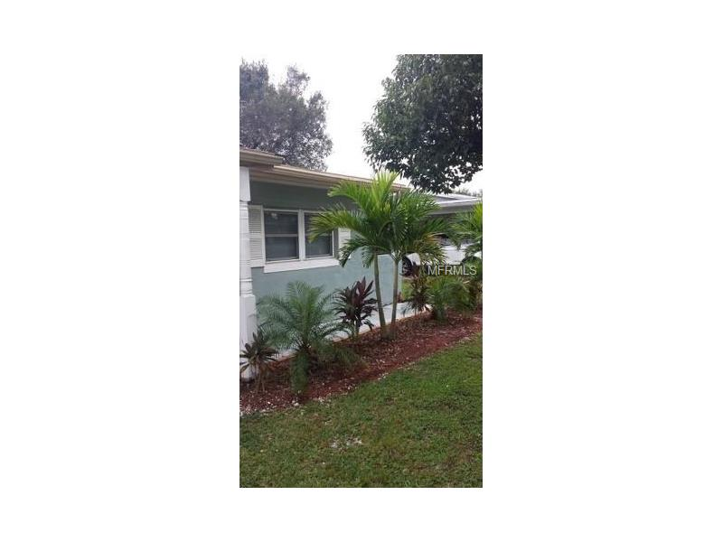 Can't beat this location!  Minutes from Largo Mall, the beaches, Seminole Mall, and easy access to the Interstate.  Come see this totally updated 2 bedroom, 1 bath, extra room home located on a quiet street. Beautiful new kitchen, bathroom, and flooring! Huge bonus room that could be a 3rd bedroom or turned into a master suite! Home has mature landscaping, 1 car garage, and is ready for many back yard cook outs.  Washer/dryer hook up are located in the large 1 car garage.  Close to everything in a great school zone!  Come see this beautiful home today because it won't last long!