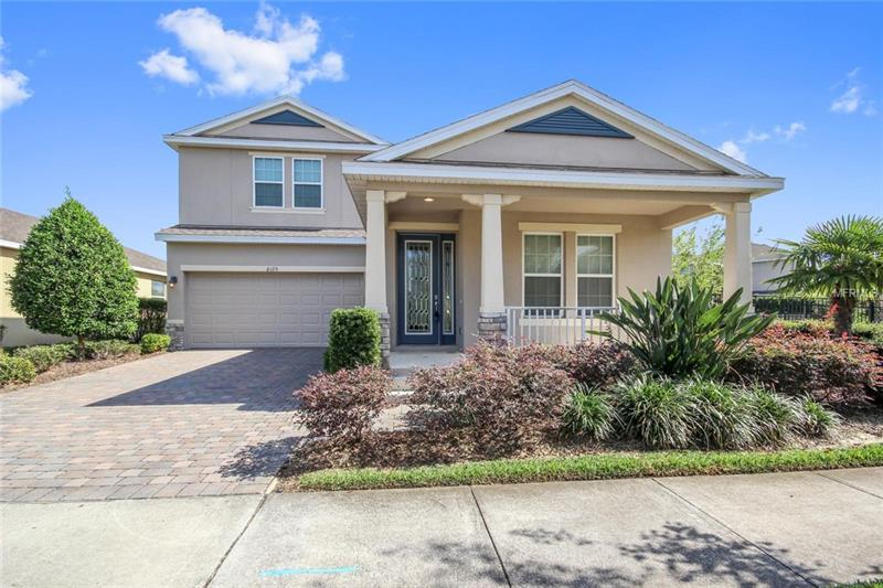 Move into one of Central Florida's newest communities without waiting to build.  Come home to the rolling hills and orange groves of West Orange County in an active community offering numerous organized events and activities, plus you'll always be in the loop thanks to the monthly newsletter.  Your new 2 story home located on a spacious fully fenced lot features the **MASTER BEDROOM DOWNSTAIRS.**  MODERN UPDATES INCLUDE-GE PRO ELITE WATER FILTER (WHOLE HOUSE IN 2013), GE PRO ELITE REVERSE OSMOSIS (2013), BLACK ANODIZED FENCE (2015), PRIVACY HEDGES (2016) The family chef will love the kitchen showcasing STAINLESS STEEL APPLIANCES INCLUDING A GAS RANGE and a center island prep area-open to the dining and family room with abundant windows and sliders to the outdoor living space.  The upstairs loft area allows for additional space for a secondary living space, reading room or whatever fits your families needs.  Relax on your back covered patio!  Easy 429 access plus Winter Garden Village shopping and dining are a short 10-15 min drive while Orange County National Golf Center practically next door.  Head to the community rec center boasting a resort-style pool, fitness and play area or take your pet on a walk at the dog park while the HOA maintains the lawn.  Your new home is waiting!