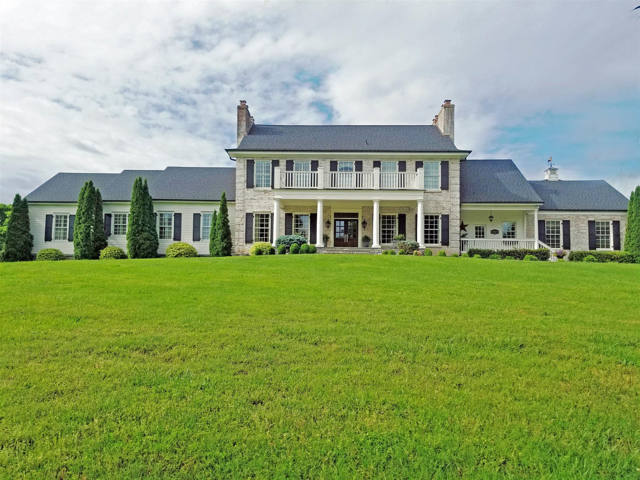 A dream come true...spectacular gated estate home, pool, pool house, barn and pond on approx 17 acres off historic Old Smyrna Rd in the heart of Brentwood! This home is picture perfect and ready to move in...don't miss this opportunity!