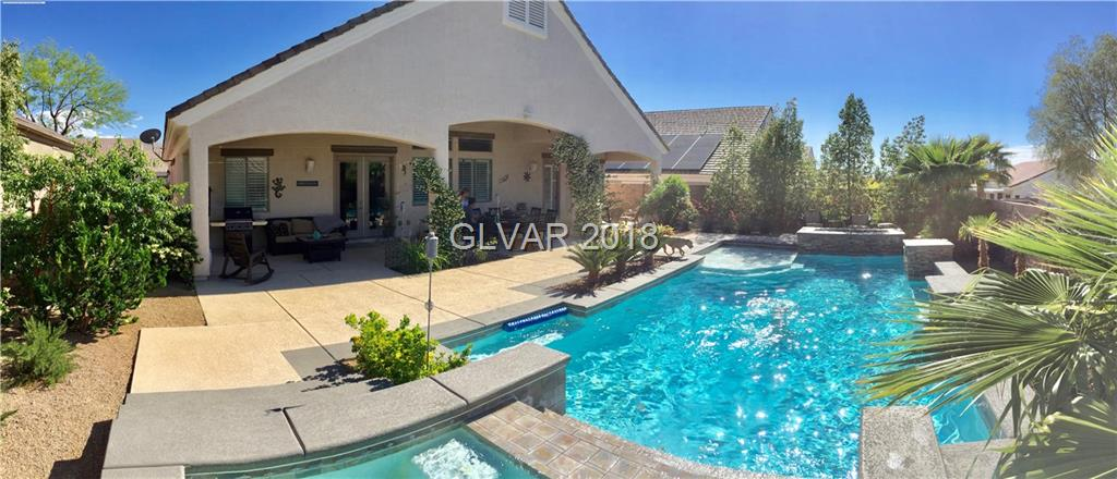 Absolutely gorgeous home with a great location.The property sits on two parcels: 178-31-817-047 & 178-32-413-124, for a total of 9583 sq. ft. Many upgrades & extras. Premium front doors, premium ceramic tile & carpet, 12' ceilings at most areas, quality cabinets in kitchen with slab granite counters & full back splash, breakfast bar, Kitchen aid stainless. A breathtaking swimming pool just waiting for you!