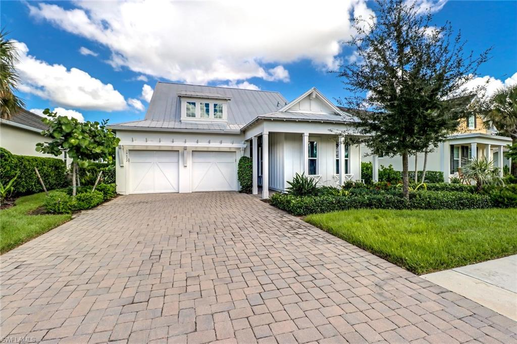 Welcome to Naples Reserve - a picturesque, Florida lifestyle community! This immaculate Ashton Woods Capri model was built in 2016. At 2,294 square feet, this gorgeous home offers 3 spacious bedrooms, 3 full baths, 1 half bath, den, eat-in kitchen, and open great room. Notable features include hurricane impact windows and doors, custom kitchen cabinetry, beautiful quartz countertops with large waterfall-edge center island, and upgraded flooring. Outdoor features include metal roof, pavered driveway, extended pavered lanai with picture-window screen enclosure and soothing water feature, built-in gas fire pit, lush tropical landscaping and stunning lake view. Naples Reserve features a large resort-style pool, private lakefront beach and dining. You can enjoy communities activities such as tennis, pickleball, bocce ball, beach volleyball, kayaking/canoeing and many biking/walking trails. There's even a Bark Park for your furry companions to enjoy!