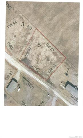 Affordable lot in established community.  Nice mountain views with easy access.  Doublewides, modular or site built.  Minimum square footage 1500 one level, 1800 for two.  Septic permit is expired.