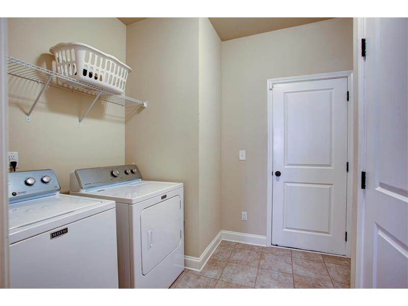Oversized laundry room conveniently located off kitchen & walk-thru to 3 car garage!