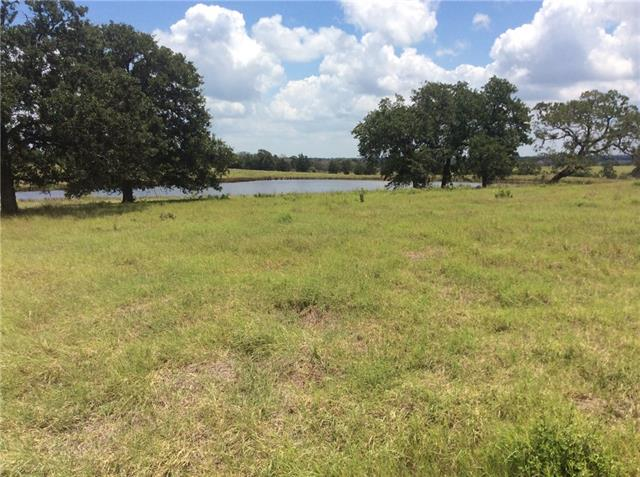 Beautiful rolling hills w/ mix of post oak trees & a few pine. Improved property w/ coastal bermuda grass in sandy loam soil. Large pond on the property. Electricity & public water meter are at P.R. 2102 at the entrance to the property. White tailed deer, wild hogs & occasional wild turkeys. P.R. runs along entire front of property. Property is ag exempt & perimeter fencing good. Seller will be retaining all seller-owned minerals but willing to waive surface rights to those minerals. Aerial is attached.